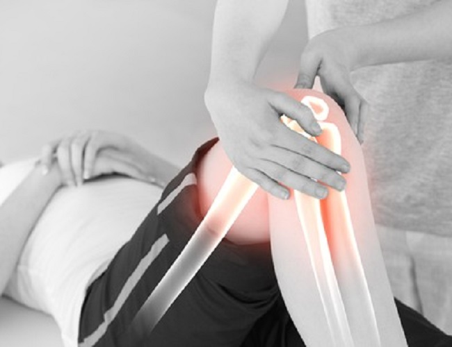 40311801 - digital composite of highlighted bones of woman at physiotherapist